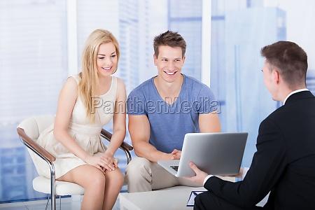 financial advisor explaining investment plan to