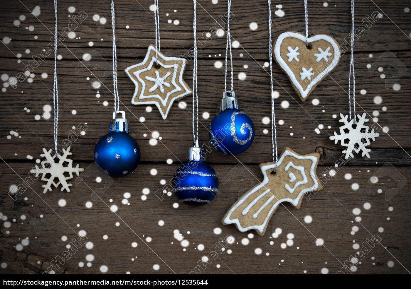 christmas, decorations, hanging, in, the, snow - 12535644