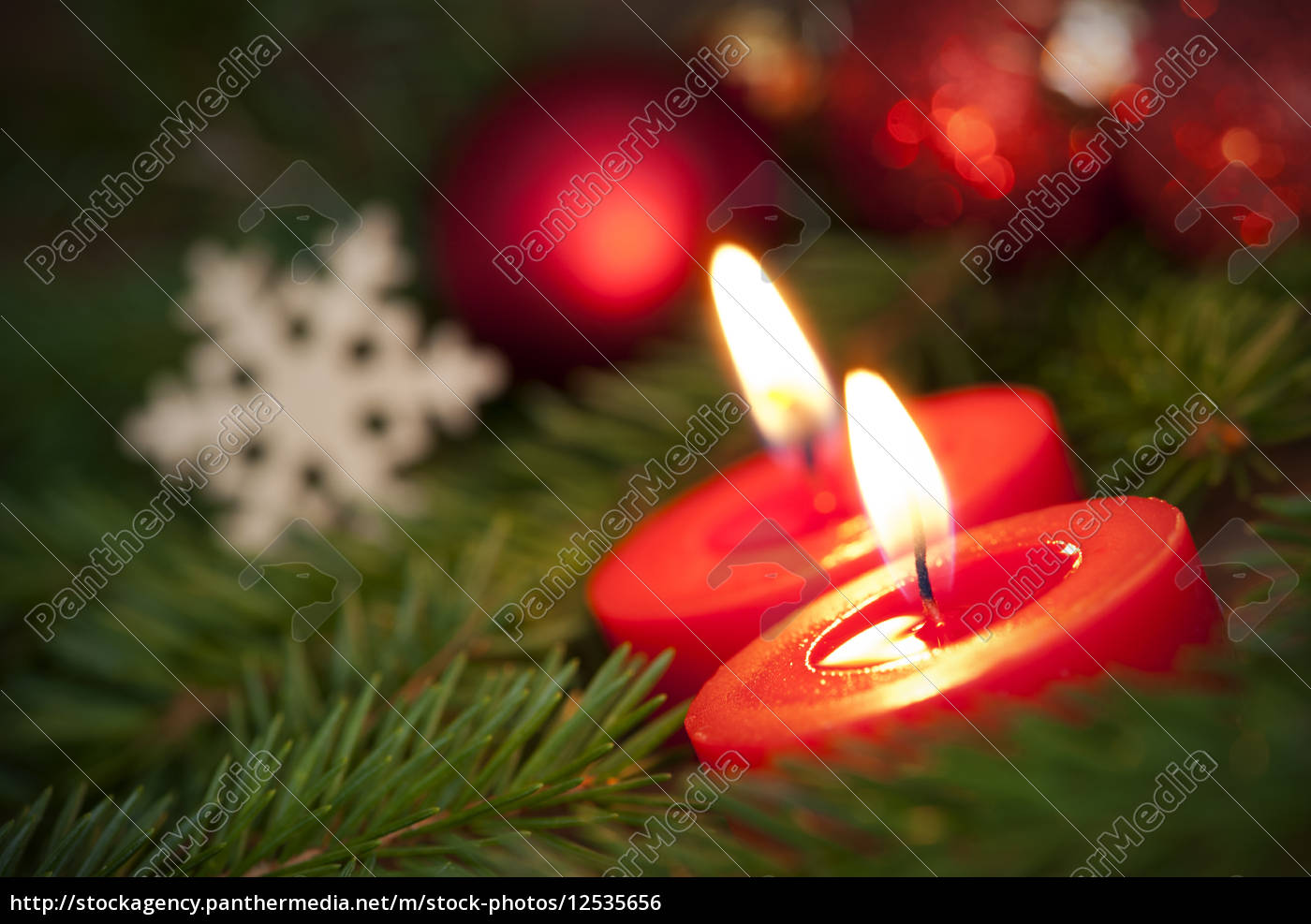macro, of, two, burning, candles, with - 12535656