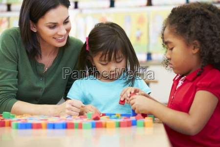 elementary pupils counting with teacher in