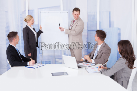 businessman giving presentation to colleagues in