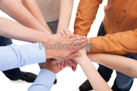 friends, with, their, hands, stacked, together - 12536342