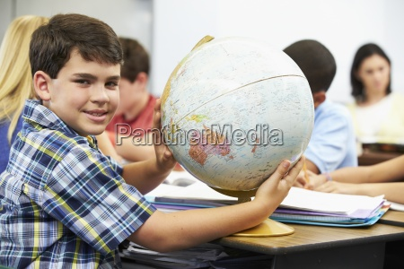 pupils, studying, geography, in, classroom - 12536470