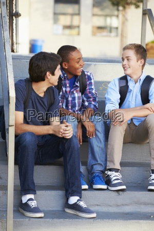 group of male teenage pupils outside