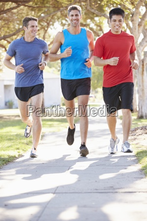 group of male runners exercising on