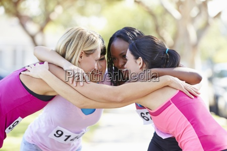 female runners congratulating one another after