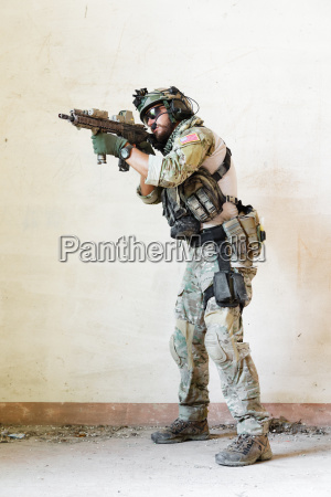 soldier pointing his rifle during the