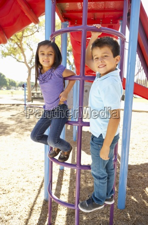 boy and girl on climbing frame