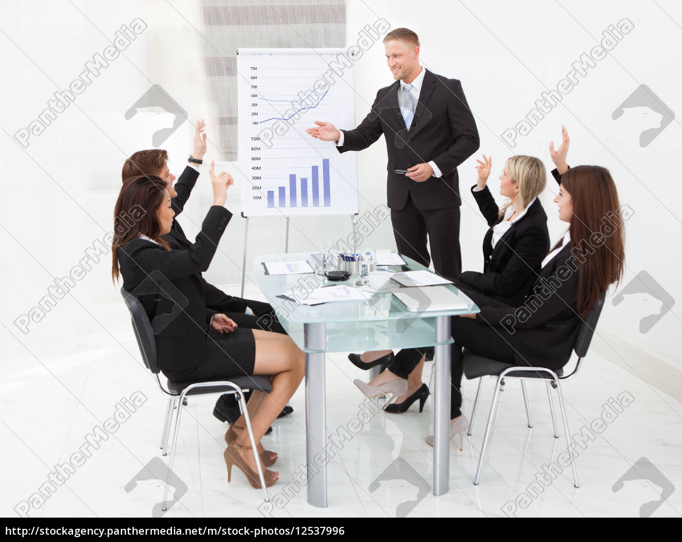 businesspeople, answering, businessman, in, meeting - 12537996