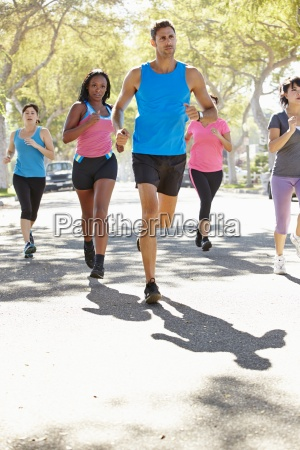 group, of, women, running, along, street - 12537338