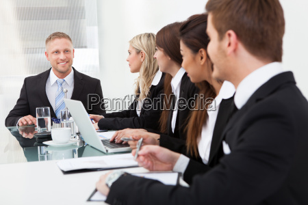 businessman looking at colleagues in meeting