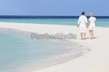 senior romantic couple walking on beautiful