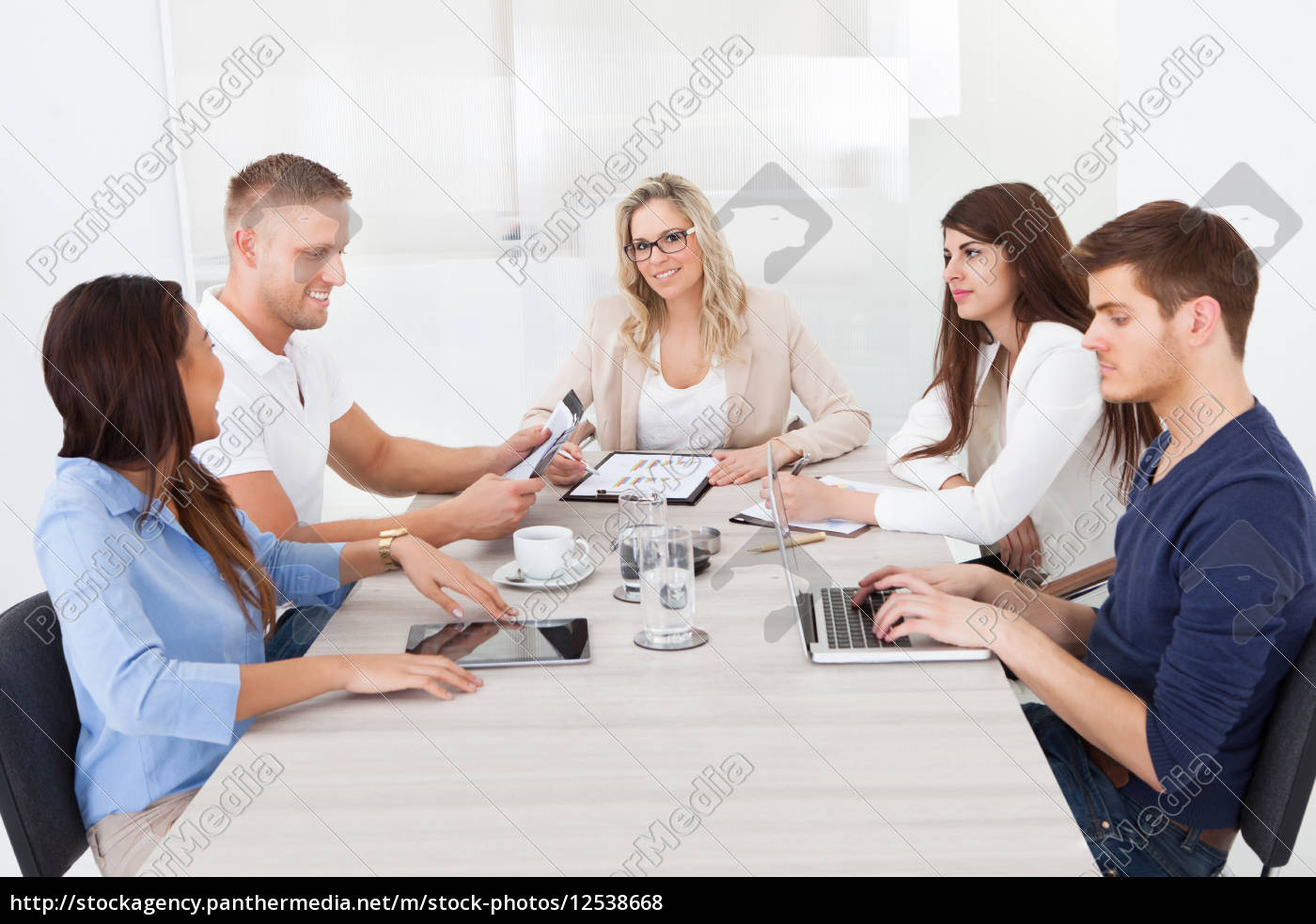 businesswoman, in, meeting, with, colleagues - 12538668