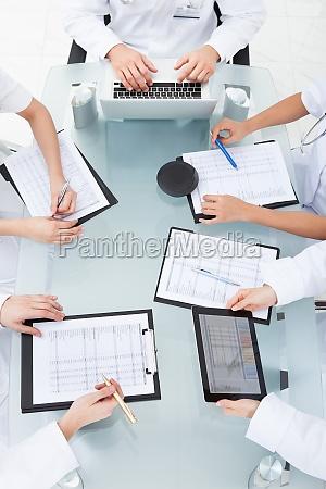 doctors, examining, medical, reports - 12538206