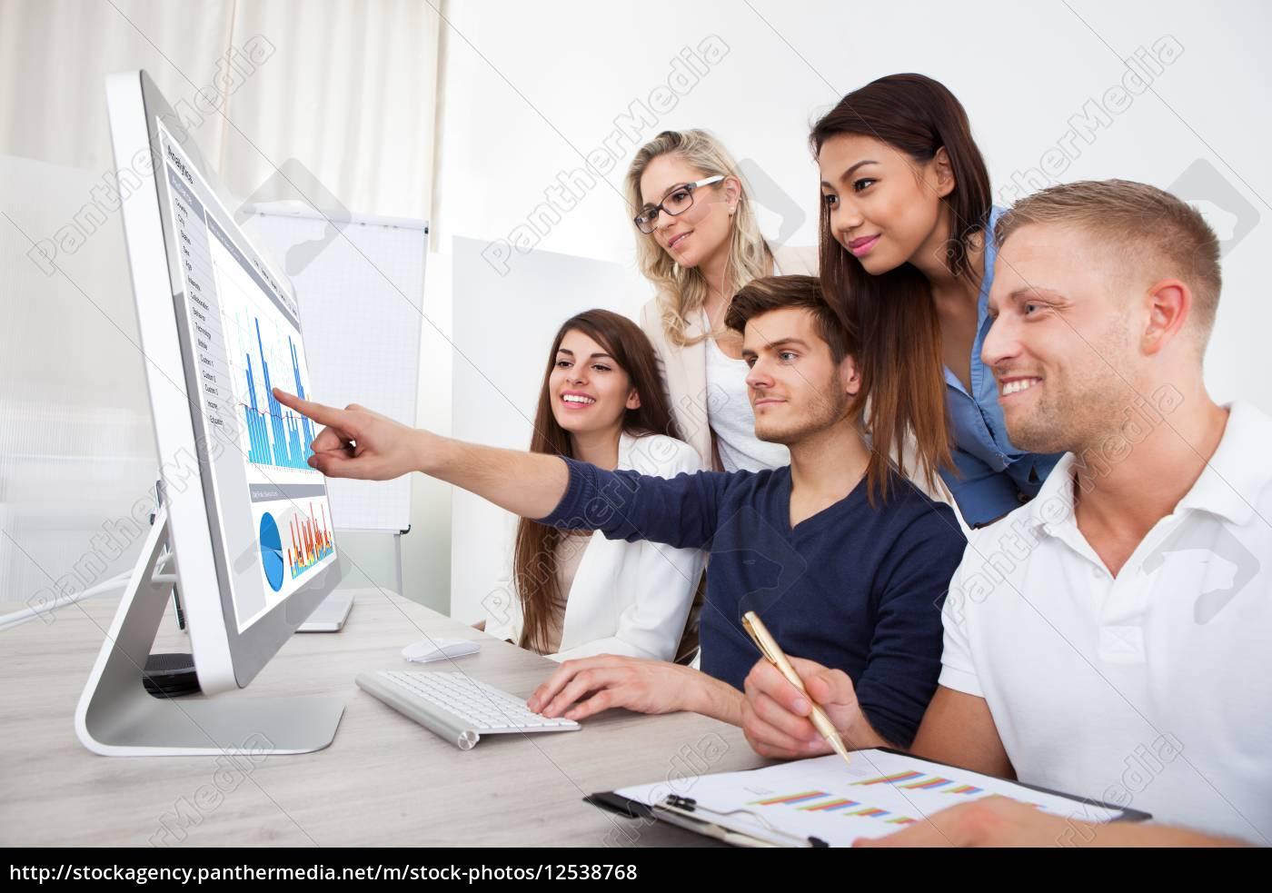 smiling, businesspeople, using, desktop, pc - 12538768