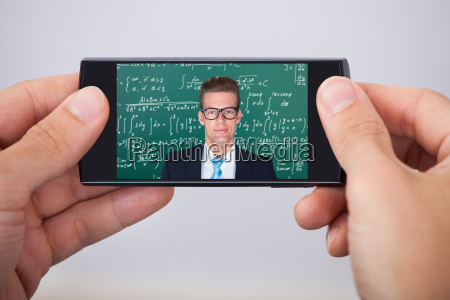man attending online maths lecture
