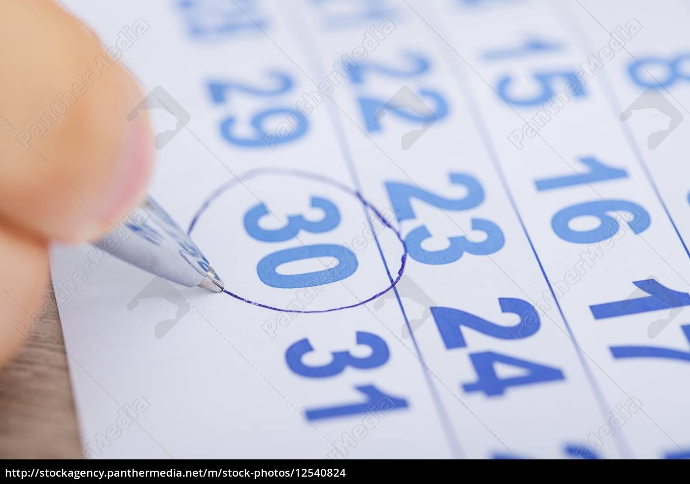 businessman, marking, date, on, calendar, at - 12540824