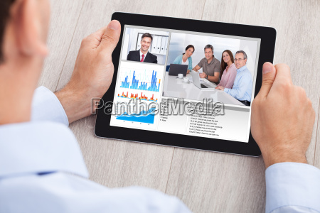 businessman, video, conferencing, with, team, on - 12540804