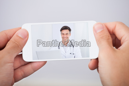 man, having, video, chat, with, doctor - 12540256