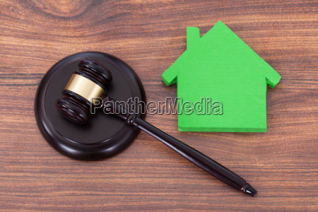 mallet on block by green house