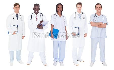 multiethnic doctors over white background