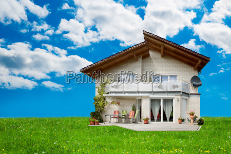 exterior of house on grassy landscape