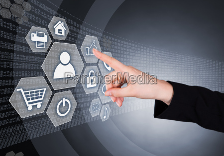businesswoman touching transparent screen