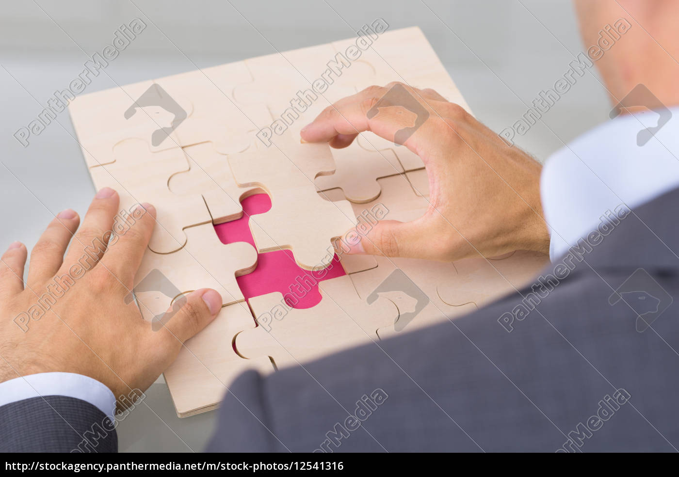 businessman, assembling, jigsaw, puzzle - 12541316