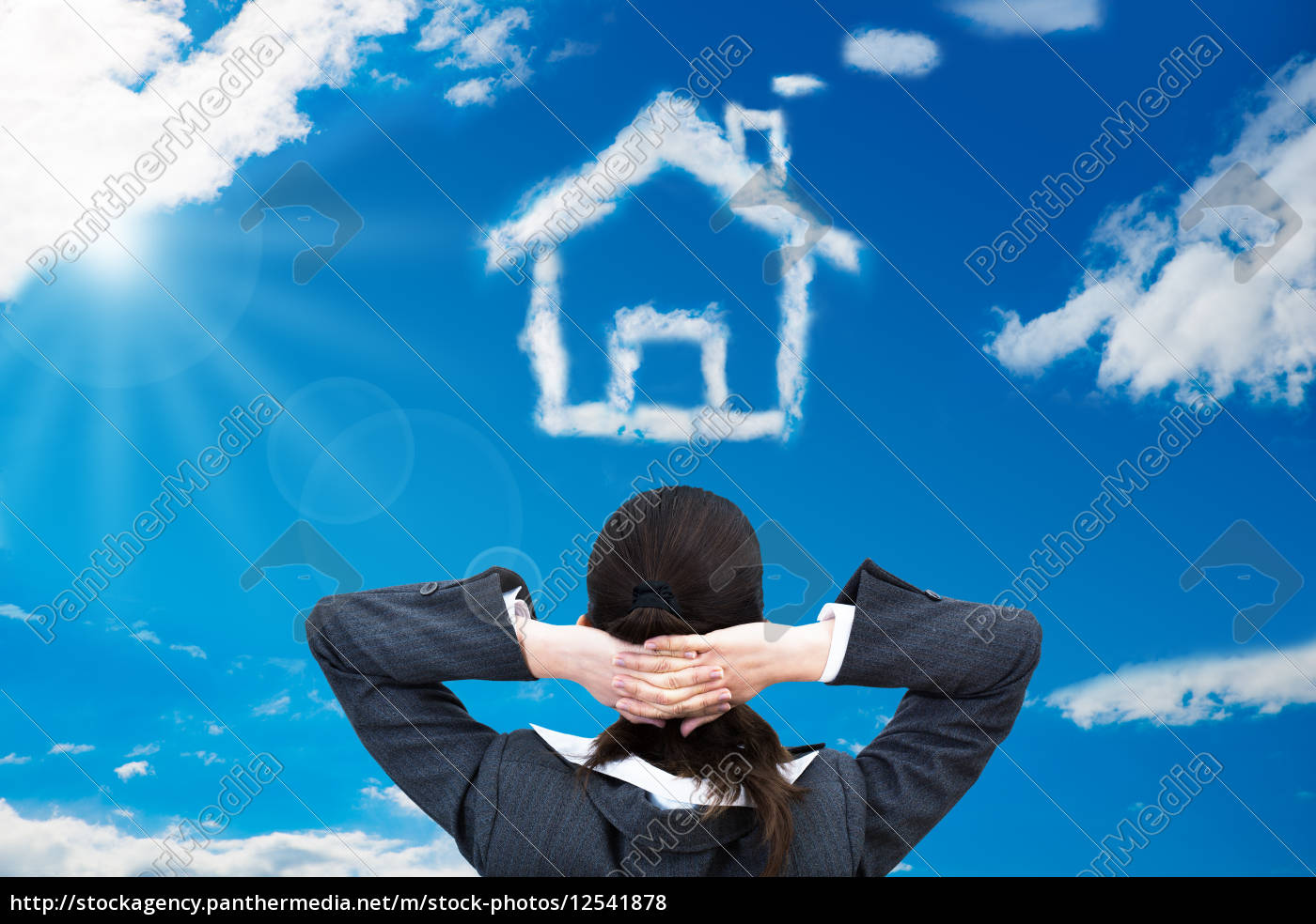 businesswoman, looking, at, house, shaped, cloud - 12541878