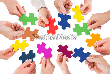 five people hand with puzzle