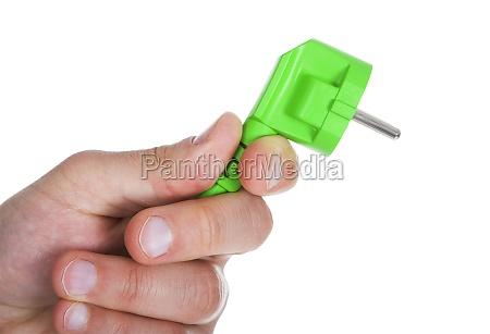 hand holding green pin plug