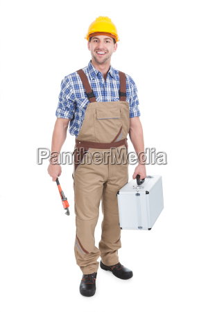 confident young male worker with wrench