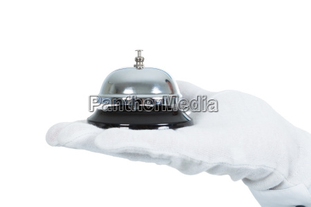 hand with service bell over white