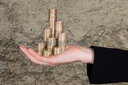 businessman, holding, stacked, coins - 12542996