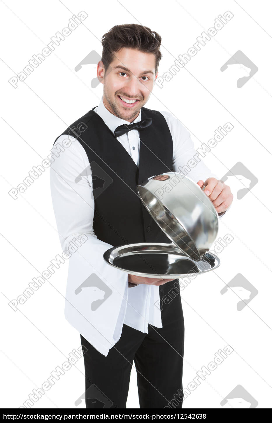 butler, lifting, cloche, from, serving, tray - 12542638