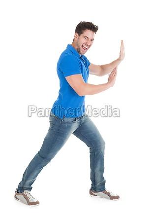 confident, man, pushing, billboard - 12542662