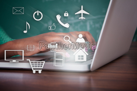 teacher, using, laptop, at, desk - 12542958