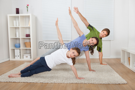 fit family doing side plank yoga