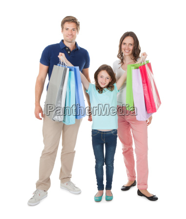 portrait of happy family with shopping