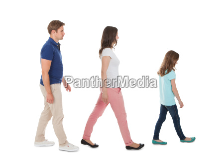 family walking in a row over