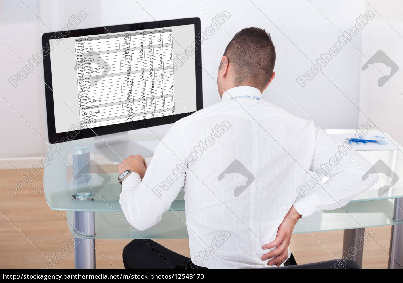 businessman, with, backache, using, computer, at - 12543170