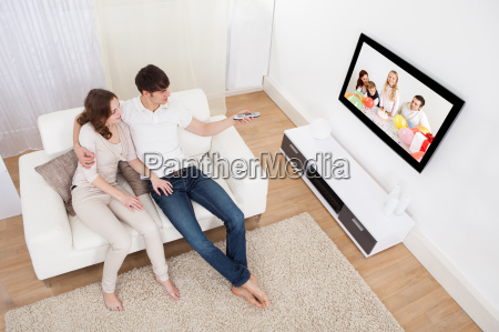 couple, in, livingroom, watching, television - 12543934