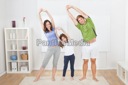 portrait, of, fit, family, performing, yoga - 12543634