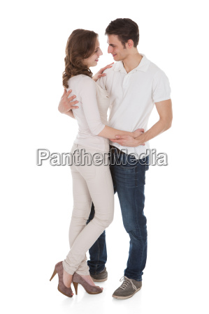 couple, in, casuals, embracing, over, white - 12544190