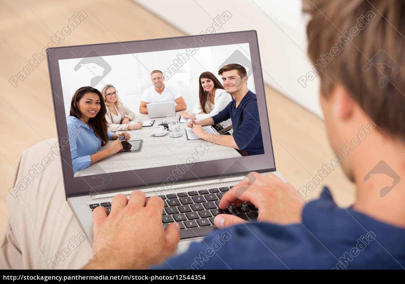 man, attending, conference, meeting, on, laptop - 12544354