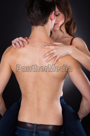 man, carrying, woman, while, getting, intimate - 12544098
