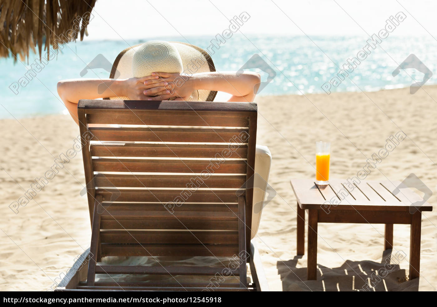 woman, relaxing, on, deck, chair, at - 12545918