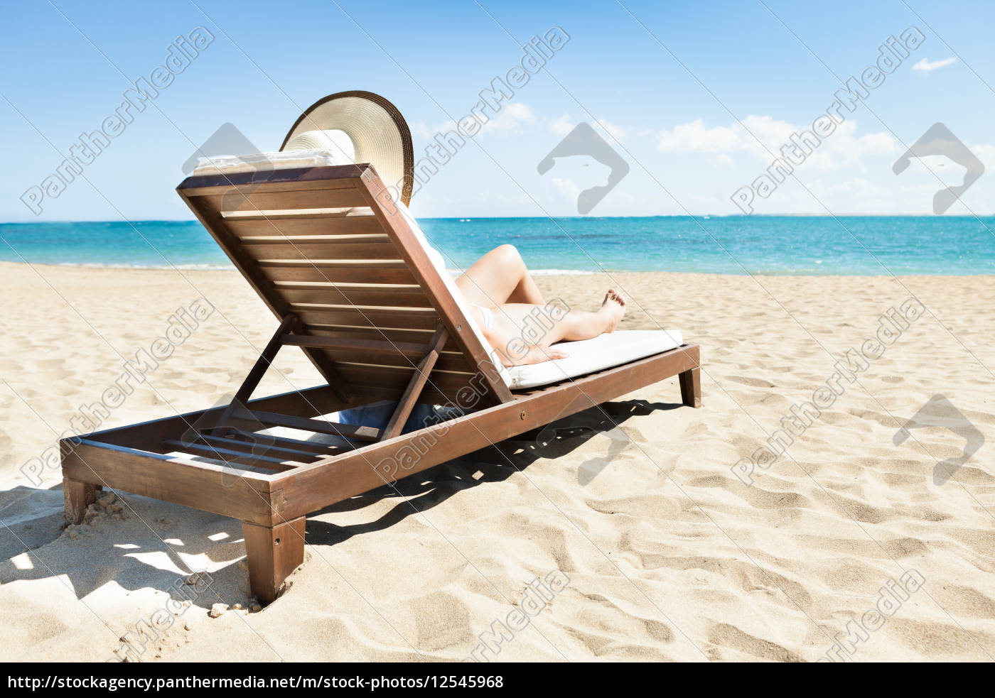 woman, sunbathing, on, deck, chair, at - 12545968