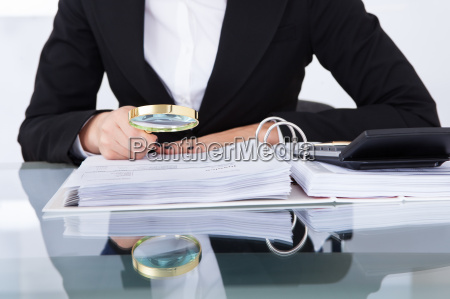 auditor, scrutinizing, financial, documents - 12546630