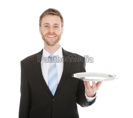 businessman holding empty tray over white